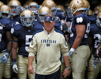 SOUTH BEND, IN - SEPTEMBER 11: Head coach Brian Kelly of the Notre Dame Fighting Irish waits to enter the field with his team before a game against the Michigan Wolverines at Notre Dame Stadium on September 11, 2010 in South Bend, Indiana. Michigan defeat