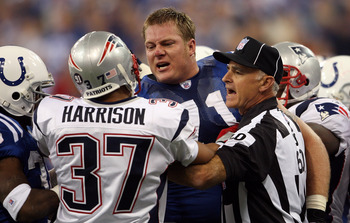 INDIANAPOLIS - NOVEMBER 04:  Line judge Gary Cavaletto #60 attempts to seperate Ryan Diem #71 of the Indianapolis Colts and Rodney Harrison #37 of the New England Patriots during the first quarter of their game on November 4, 2007 at the RCA Dome in India