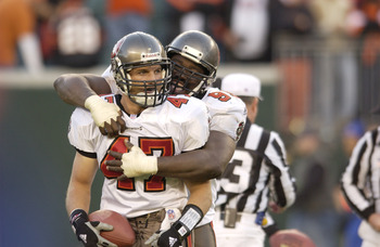 02 Dec 2001 : John Lynch #47 of the Tampa Bay Buccaneers is congratulated by teammate Warren Sapp #99 , after recovering a fumble , which set up the winning field goal against the Cincinnati Bengals during the game at Paul Brown Stadium in Cincinnati, Ohi