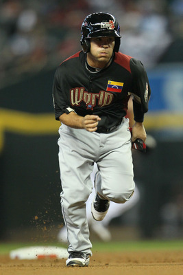 PHOENIX, AZ - JULY 10:  World Future's All-Star Jose Altuve #2 of the Houston Astros runs to third base during the 2011 XM All-Star Futures Game at Chase Field on July 10, 2011 in Phoenix, Arizona.  (Photo by Jeff Gross/Getty Images)