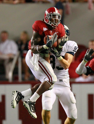 TUSCALOOSA, AL - SEPTEMBER 11:  Mark Barron #4 of the Alabama Crimson Tide intercepts a pass intended for Brett Brackett #83 of the Penn State Nittany Lions at Bryant-Denny Stadium on September 11, 2010 in Tuscaloosa, Alabama.  (Photo by Kevin C. Cox/Gett