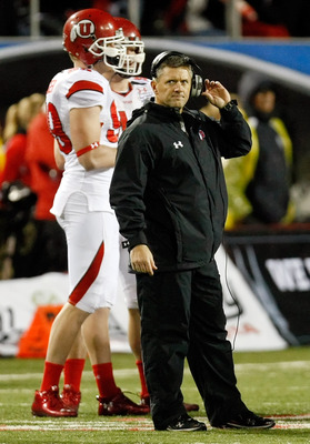 LAS VEGAS, NV - DECEMBER 22:  Head coach Kyle Whittingham of the Utah Utes stands on the field during a time-out in the MAACO Bowl Las Vegas against the Boise State Broncos at Sam Boyd Stadium December 22, 2010 in Las Vegas, Nevada. Boise State Won 26-3.