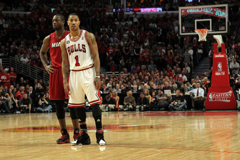 CHICAGO, IL - MAY 26:  Derrick Rose #1 of the Chicago Bulls lines up against Dwyane Wade #3 of the Miami Heat in Game Five of the Eastern Conference Finals during the 2011 NBA Playoffs on May 26, 2011 at the United Center in Chicago, Illinois. NOTE TO USE