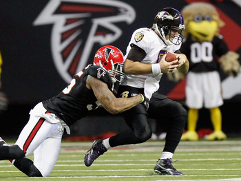 ATLANTA - NOVEMBER 11:  John Abraham #55 of the Atlanta Falcons sacks quarterback Joe Flacco #5 of the Baltimore Ravens at Georgia Dome on November 11, 2010 in Atlanta, Georgia.  (Photo by Kevin C. Cox/Getty Images)