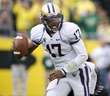 EUGENE, OR - NOVEMBER 06: Quarterback Keith Price #17 of the Washington Huskies scrambles out of the pocket in the third quarter of the game against the Oregon Ducks at Autzen Stadium on November 6, 2010 in Eugene, Oregon. The Ducks won the game 53-16. (P
