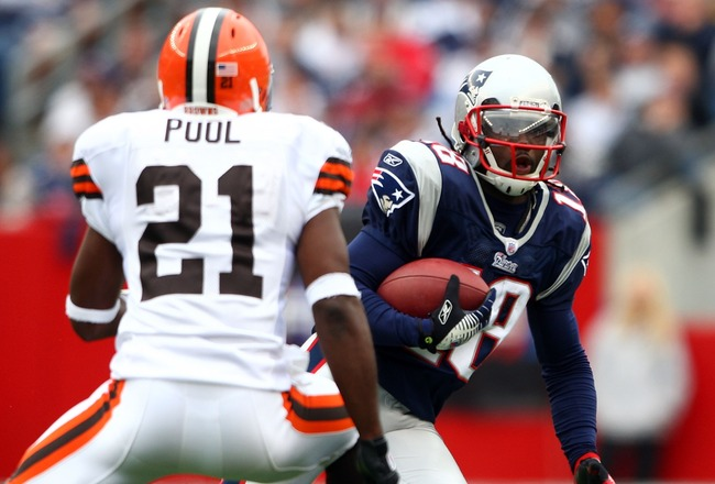 FOXBORO, MA - OCTOBER 07:  Donte Stallworth #18 of the New England Patriots carries the ball as Brodney Pool #21 of the Cleveland Browns defends on October 7, 2007 at Gillette Stadium in Foxboro, Massachusetts.  (Photo by Elsa/Getty Images)