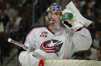 DENVER, CO - MARCH 22:  Goalie Steve Mason #1 of the Columbus Blue Jackets takes a drink during a break in the action against the Colorado Avalanche at the Pepsi Center on March 22, 2011 in Denver, Colorado. Mason collect the loss as the Avalanche defeate