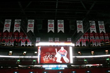 MONTREAL- NOVEMBER 22:  The scoreboard at the Bell Centre displays images of Patrick Roy with Stanley Cup banners and retired numbers in the background before the game between the Boston Bruins and Montreal Canadiens at the Bell Centre on November 22, 200