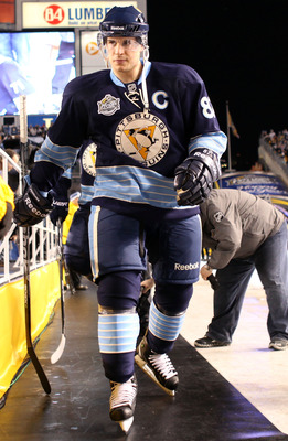PITTSBURGH, PA - JANUARY 01:  Captain Sidney Crosby #87 of the Pittsburgh Penguins walks out to the ice before playing against the Washington Capitals during the 2011 NHL Bridgestone Winter Classic at Heinz Field on January 1, 2011 in Pittsburgh, Pennsylv