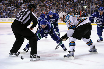 VANCOUVER, CANADA - MAY 24:  Henrik Sedin #33 of the Vancouver Canucks takes the faceoff against Joe Thornton #19 of the San Jose Sharks in Game Five of the Western Conference Finals during the 2011 Stanley Cup Playoffs at Rogers Arena on May 24, 2011 in