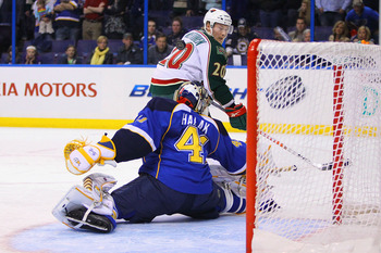 ST. LOUIS, MO - MARCH 29: Jaroslav Halak #41 of the St. Louis Blues makes a save against Antti Miettinen #20 of the Minnesota Wild  during the penalty shoot out at the Scottrade Center on March 29, 2011 in St. Louis, Missouri.  The Wild beat the Blues 3-2