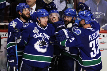 VANCOUVER, BC - JUNE 10:  Alex Burrows #14 and Henrik Sedin #33 of the Vancouver Canucks celebrate after a goal in the third period during Game Five of the 2011 NHL Stanley Cup Final at Rogers Arena on June 10, 2011 in Vancouver, British Columbia, Canada.