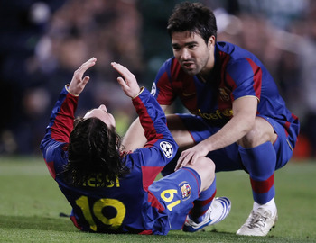 BARCELONA, SPAIN - MARCH 04:  Lionel Messi (L) of Barcelona reacts beside teamate Deco after getting injured during the UEFA Champions League 2nd leg of the First knockout round match between FC Barcelona and Celtic at the Camp Nou stadium on March 4, 200