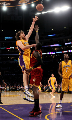LOS ANGELES, CA - JANUARY 11:  Pau Gasol #16 of the Los Angeles Lakers shoots over J.J. Hickson #21 of the Cleveland Cavaliers at Staples Center on January 11, 2011 in Los Angeles, California.   NOTE TO USER: User expressly acknowledges and agrees that, b