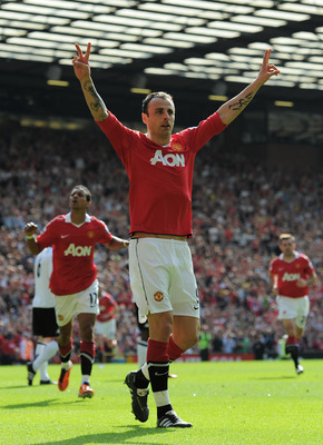 MANCHESTER, ENGLAND - APRIL 09:  Dimitar Berbatov of Manchester United celebrates scoring the opening goal during the Barclays Premier League match between Manchester United and Fulham at Old Trafford on April 9, 2011 in Manchester, England.  (Photo by Mi