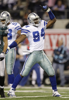 ARLINGTON, TX - JANUARY 9:  DeMarcus Ware #94 of the Dallas Cowboys reacts after the Cowboys recovered a second quarter fumble by Michael Vick #7 of the Philadelphia Eagles during the 2010 NFC wild-card playoff game at Cowboys Stadium on January 9, 2010 i