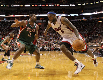 MIAMI, FL - JANUARY 04:  LeBron James #6 of the Miami Heat dribbles around John Salmons #15 of the Milwaukee Bucks during a game at American Airlines Arena on January 4, 2011 in Miami, Florida. NOTE TO USER: User expressly acknowledges and agrees that, by