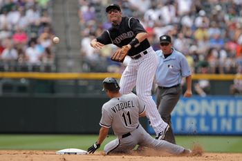 DENVER, CO - JUNE 30:  Shortstop Troy Tulowitzki #2 of the Colorado Rockies turns a double play as he gets the force on Omar Vizquel #11 of the Chicago White Sox at second on a ground ball by Adam Dunn of the White Sox in the fifth inning during Interleag
