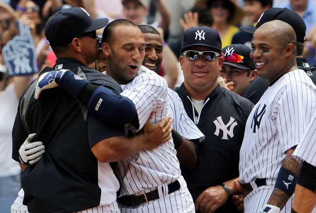 NEW YORK, NY - JULY 09:  Derek Jeter #2 of the New York Yankees celebrates at home with teammates Alex Rodriguez #13, Bartolo Colon #40 and Andruw Jones #18  after hitting a solo home run in the third inning for career hit 3000 while playing against the T