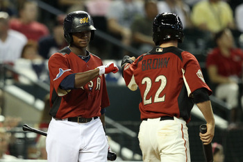 PHOENIX, AZ - JULY 10:  U.S. Futures All-Star Tim Beckham #22 of the Tampa Bay Rays congratulates U.S. Futures All-Star Gary Brown #22 of the San Francisco Giants after Brown scored on a double by U.S. Futures All-Star Grant Green #6 of the Oakland Athlet