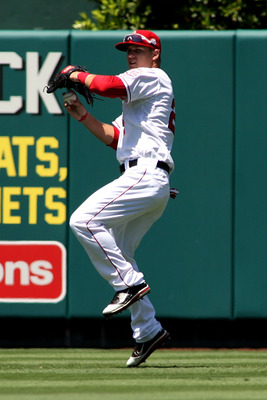 ANAHEIM, CA - JULY 10:  Mike Trout #27 of the Los Angeles Angels of Anaheim throws the ball back to the infield after catching a fly ball against the Seattle Mariners for the second out in the seventh inning of the game at Angel Stadium of Anaheim on July