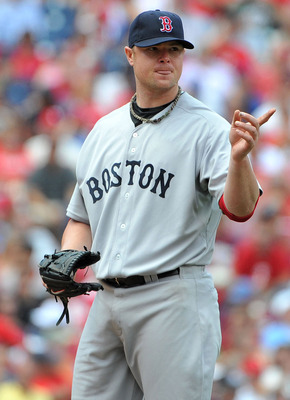 PHILADELPHIA - JUNE 30: Jon Lester #31 of the Boston Red Sox motions towards first base prior to throwing a pitch in the bottom of the fourth inning against the Philadelphia Phillies at Citizens Bank Park on June 30, 2011 in Philadelphia, Pennsylvania. (P