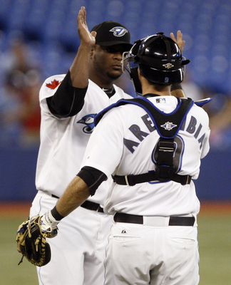 TORONTO, CANADA - JUNE 15:  Frank Francisco #50 of the Toronto Blue Jays and J.P. Arencibia #9 of the Toronto Blue Jays celebrate win during MLB action against the Baltimore Orioles at The Rogers Centre June 15, 2011 in Toronto, Ontario, Canada. (Photo by