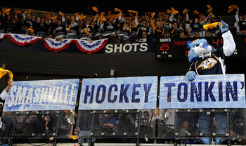 NASHVILLE, TN - APRIL 17:  Team mascot, Gnash, of the Nashville Predators waves a rally towel to motivate the crowd in a game against the Anaheim Ducks in Game Three of the Western Conference Quarterfinals during the 2011 NHL Stanley Cup Playoffs at the B