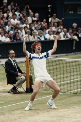 4 JUL 1981:  JOHN MCENROE OF THE UNITED STATES CELEBRATES AS HE WINS THE MENS SINGLES TITLE AT THE 1981 WIMBLEDON TENNIS CHAMPIONSHIPS. MCENROE DEFEATED BJORN BORG OF SWEDEN 4-6, 7-6, 7-6, 6-4 TO TAKE THE TITLE.