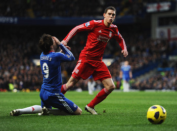 LONDON, ENGLAND - FEBRUARY 06:  Fernando Torres of Chelsea holds his face after a  is challenge by Daniel Agger of Liverpool during the Barclays Premier League match between Chelsea and Liverpool at Stamford Bridge on February 6, 2011 in London, England.