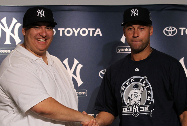 NEW YORK, NY - JULY 09:  New York Yankees fan Christian Lopez (L) shakes hands with Derek Jeter #2 of the New York Yankees  after catching a home run which was the 3000th of Derek Jeter's career at Yankee Stadium on July 9, 2011 in the Bronx borough of Ne