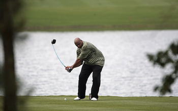 BIRMINGHAM, AL - MAY 14: Former basketball star Charles Barkley tees off on the fifth hole during the Thursday Pro-AM of the Regions Charity Classic at the Robert Trent Jones Golf Trail at Ross Bridge on May 14, 2009  in Birmingham, Alabama. (Photo by Dav