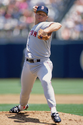 OAKLAND ,CA -1991:  Roger Clemens #21 of the Boston Red Sox winds back to pitch the ball during the game  against the Oakland Athletics in 1991 at Oakland Coliseum in Oakland, California.  (Photo by Otto Greule Jr/Getty Images)