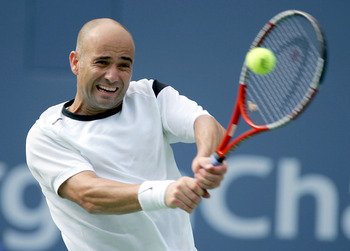 NEW YORK - SEPTEMBER 9:   Andre Agassi returns to Roger Federer of Switzerland during the US Open September 9, 2004 at the USTA National Tennis Center in Flushing Meadows Corona Park in the Flushing neighborhood of the Queens borough of New York. Federer