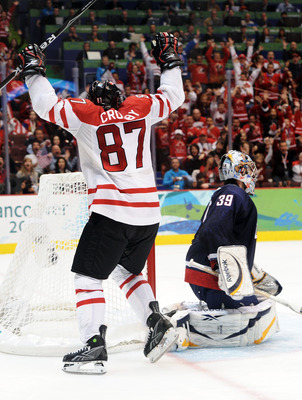 VANCOUVER, BC - FEBRUARY 28:  Sidney Crosby #87 of Canada celebrates after scoring the matchwinning goal in overtime whilst a dejected Ryan Miller #39 of the United States looks on during the ice hockey men's gold medal game between USA and Canada on day