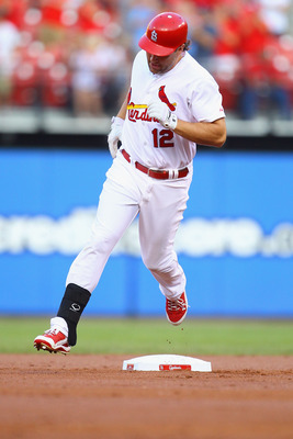 ST. LOUIS, MO - JULY 8: Lance Berkman #12 of the St. Louis Cardinals rounds the bases after hitting a solo home run against the Arizona Diamondbacks at Busch Stadium on July 8, 2011 in St. Louis, Missouri.  (Photo by Dilip Vishwanat/Getty Images)