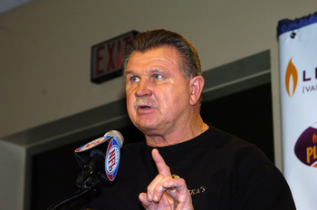 NFL Pro Football Hall of Famer Mike Ditka helps present Jerome Bettis with the Levitra Play of the year Award at the Jacksonville Convention Center on February 2, 2005  (Photo by Al Messerschmidt/Getty Images)