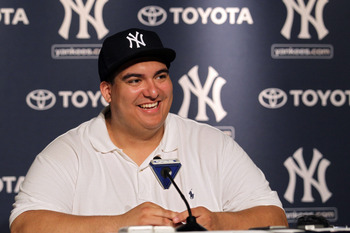 NEW YORK, NY - JULY 09:  New York Yankees fan Christian Lopez speaks to the media after catching a home run which was the 3000th hit of Derek Jeter career at Yankee Stadium on July 9, 2011 in the Bronx borough of New York City.  (Photo by Nick Laham/Getty