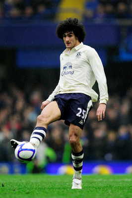 LONDON, ENGLAND - FEBRUARY 19:  Marouane Fellaini of Everton passes the ball during the FA Cup sponsored by E.ON 4th round replay match between Chelsea and Everton at Stamford Bridge on February 19, 2011 in London, England.  (Photo by Jamie McDonald/Getty