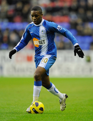WIGAN, ENGLAND - JANUARY 15: Charles N'Zogbia of Wigan plays the ball during the Premier League match between Wigan Athletic and Fulham at the DW Stadium on January 15, 2011 in Wigan, England.  (Photo by Michael Regan/Getty Images)