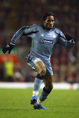 LIVERPOOL - MARCH 11:  Didier Drogba of Marseille in action during the UEFA Cup Fourth Round, First Leg match between Liverpool and Marseille held on March 11, 2004 at Anfield, in Liverpool, England. The match ended in a 1-1 draw. (Photo by Laurence Griff