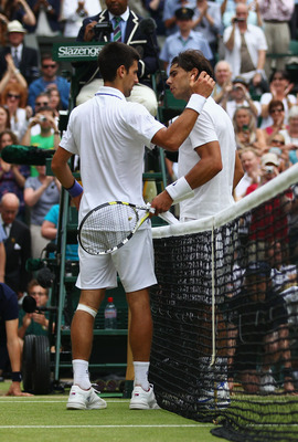 LONDON, ENGLAND - JULY 03:  Novak Djokovic of Serbia (L) shakes hands with Rafael Nadal of Spain after winning his final round Gentlemen's match on Day Thirteen of the Wimbledon Lawn Tennis Championships at the All England Lawn Tennis and Croquet Club on