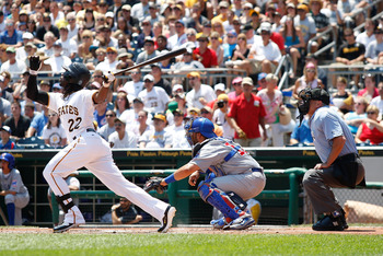 PITTSBURGH, PA - JULY 10:  Andrew McCutchen #22 of the Pittsburgh Pirates hits a sacrifice fly in the first inning against the Chicago Cubs during the game on July 10, 2011 at PNC Park in Pittsburgh, Pennsylvania.  (Photo by Jared Wickerham/Getty Images)