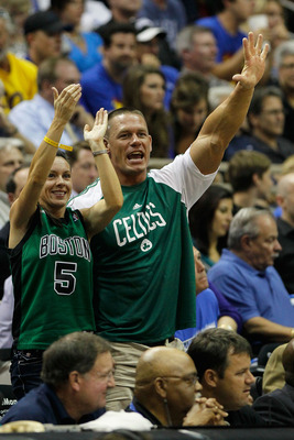 ORLANDO, FL - MAY 18:  Pro Wrestler John Cena cheeers for the Boston Celtics against of the Orlando Magic in Game Two of the Eastern Conference Finals during the 2010 NBA Playoffs at Amway Arena on May 18, 2010 in Orlando, Florida.  NOTE TO USER: User exp