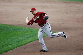 MILWAUKEE, WI - JULY 6: Kelly Johnson #2 of the Arizona Diamondbacks throws the baseball against the Milwaukee Brewers at Miller Park on July 6, 2011 in Milwaukee, Wisconsin. The Brewers defeated the Diamondbacks 3-1. (Photo by Scott Boehm/Getty Images)