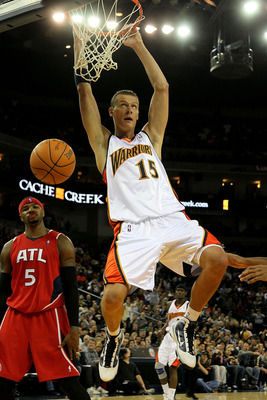 OAKLAND, CA - FEBRUARY 21:  Andris Biedrins #15 of the Golden State Warriors shoots against Josh Smith #5 of the Atlanta Hawks during an NBA game at Oracle Arena on February 21, 2010 in Oakland, California.  NOTE TO USER: User expressly acknowledges and a