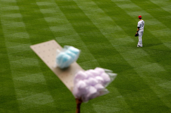 DENVER, CO - JULY 1:  Seth Smith #7 of the Colorado Rockies looks on between pitches against the Kansas City Royals as a cotton candy vendor looks for customers at Coors Field on July 1, 2011 in Denver, Colorado.  (Photo by Justin Edmonds/Getty Images)