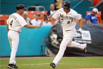 MIAMI GARDENS, FL - JULY 07:  Mike Stanton #27 of the Florida Marlins celebrates a two-run home run with third base coach Joey Espada #4 against the Houston Astros at Sun Life Stadium on July 7, 2011 in Miami Gardens, Florida.  (Photo by Marc Serota/Getty