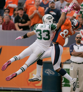 DENVER - OCTOBER 17:  Safety Eric Smith #33 the New York Jets breaks up a pass intended for Demaryius Thomas #88 of the Denver Broncos at INVESCO Field at Mile High on October 17, 2010 in Denver, Colorado.  (Photo by Justin Edmonds/Getty Images)