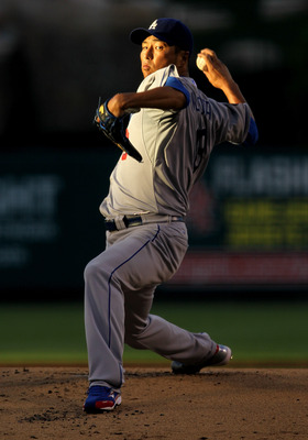 ANAHEIM, CA - JULY 01:  Hiroki Kuroda #18 of the Los Angeles Dodgers throws a pitch against the Los Angeles Angels of Anaheim on July 1, 2011 at Angel Stadium in Anaheim, California.  (Photo by Stephen Dunn/Getty Images)